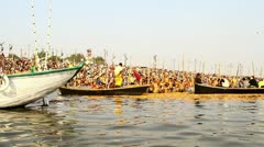 Pan shot boats in a river during Kumbh Mela - stock footage