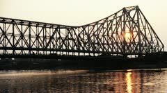 Time lapse shot of the Howrah Bridge over Hooghly River at dusk Stock Footage
