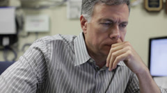 Businessman thinking about something in industrial office Stock Footage