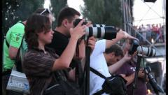 Press correspondents taking photos of event looking at cameras, click for HD Stock Footage