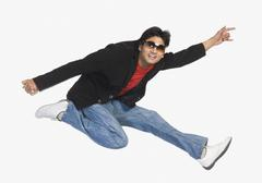 Man jumping in mid-air Stock Photos