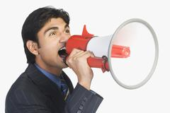 Businessman holding a megaphone Stock Photos