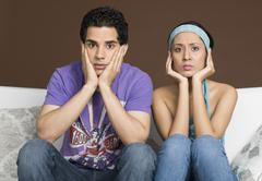Portrait of a couple looking stressed Stock Photos