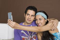 Stock Photo of Couple taking a picture of themselves with a mobile phone