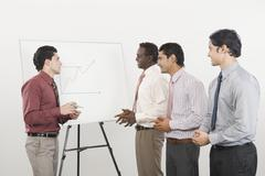 Businessman giving presentation Stock Photos