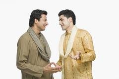 Two men talking with each other - stock photo