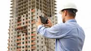 Stock Video Footage of construction engineer with the tablet. take videos construction.