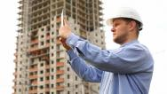 Stock Video Footage of construction engineer with the tablet. pictures of the construction site
