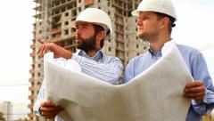 construction engineers at construction site - stock footage