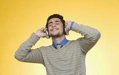 Businessman listening to headphones Stock Photos