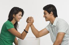 Couple arm wrestling Stock Photos