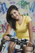 Portrait of a woman cycling Stock Photos