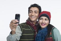Couple taking a picture of themselves with a camera phone Stock Photos