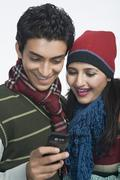 Couple looking at a mobile phone Stock Photos