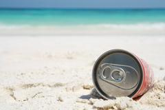 can on beach - stock photo