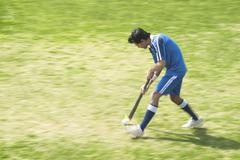 Hockey player in a field - stock photo