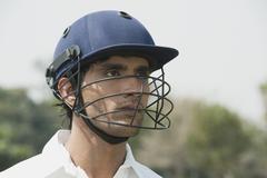 Kriketti lyöjä kypärää Kuvituskuvat