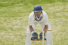 Cricket wicketkeeper behind stumps - stock photo