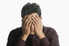Close-up of a businessman looking upset Stock Photos