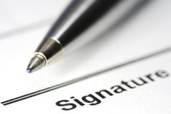 pen for signature on paper - stock photo