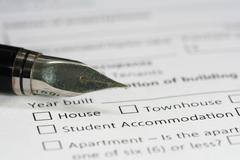 pen on housing document paper - stock photo