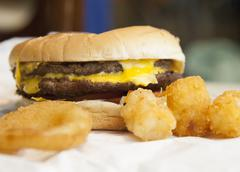 Cheeseburger with onion rings Stock Photos