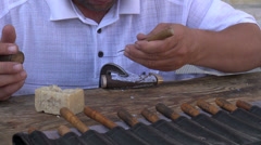 Artisan makes knives by hand in traditional workshop Uzbekistan Central Asia Stock Footage