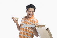 Close-up of a man looking at pizza Stock Photos