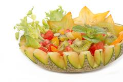 fruit salad in the melon fruit , fusion food - stock photo