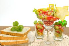bread slice and fruit salad , fusion food - stock photo