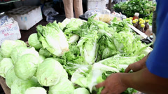 Vegetable shop at fresh public market community in Bangkok, Thailand Stock Footage