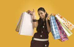 Stock Photo of Woman carrying shopping bags