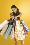 Stock Photo of Woman showing shopping bags and smiling