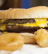 cheeseburger with onion rings - stock photo