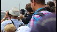 Audience crowd at day time show, looking, making photos, click for HD Stock Footage