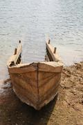 Old wood boat sank on bank, thailand Stock Photos