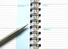 Notebook and pen on white background Stock Photos