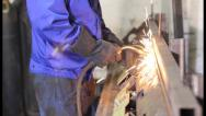 Stock Video Footage of Welder with torch is welding metal on construction site, click for HD