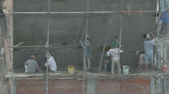 Builders are plastered wall of a building. Timelapse. - stock footage