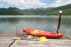 Red kayak with mountain and lake Stock Photos