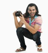 Photographer taking a picture with a digital camera Stock Photos