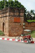 A tricycle and antique chiang mai city wall, thailand Stock Photos