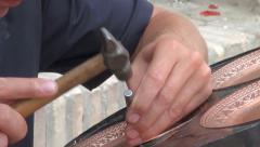 Artist in Uzbekistan, making copper plates, souvenirs, tourism, detail, closeup Stock Footage