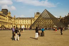 Tourists near a pyramid, Louvre Pyramid, Musee du Louvre, Paris, France - stock photo