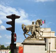 Low angle view of statues of a man with a horse, Paris, France Stock Photos