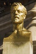 Bust of Gustave Eiffel near a tower, Eiffel Tower, Paris, France Stock Photos