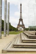 Columns with tower in the background, Eiffel Tower, Champ De Mars, Paris, France Stock Photos