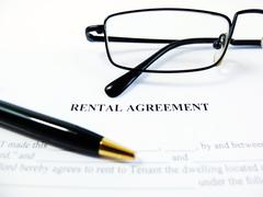 Rental Agreement with Pen and Glasses Close Up Stock Photos