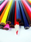 One Red Pencil Standing Out From Other Pencils Stock Photos