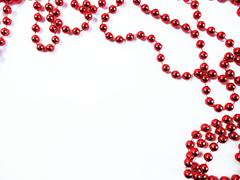 Red Christmas Decoration Beads on White Background Stock Photos